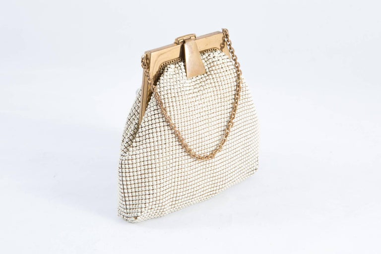 1920s Whiting & Davis ivory mini-evening small beaded bag featuring gold tone top closure, small chain handle inside silk lining.  In good vintage condition. Made in USA. Measurements:4,7in (12cm) X Bottom Width 5.5in. (14cm)   Total Handle:17.8in.