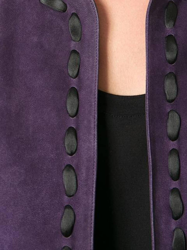 Rare Saint Laurent purple lamb suede cropped bolero jacket featuring a round neck, an open front and long sleeves and a black satin ribbon finish.  We guarantee you will receive this gorgeous item as described and showed on photos. In excellent