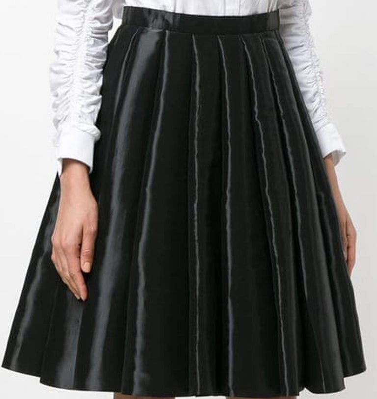 Junya Watanabe Comme des Garcons black draped flared skirt featuring a high rise, a waistband, a short length, a straight hem, a draped design and a side invisible zip fastening. See Catwalk Photo. In excellent vintage condition. Made in