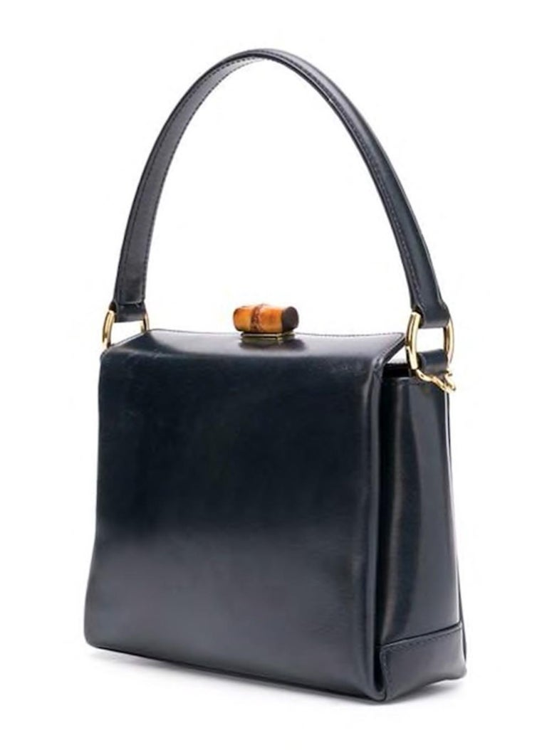 e50bff9f042 Gucci navy blue leather mini square tote bag featuring a round top handle,  a Bamboo