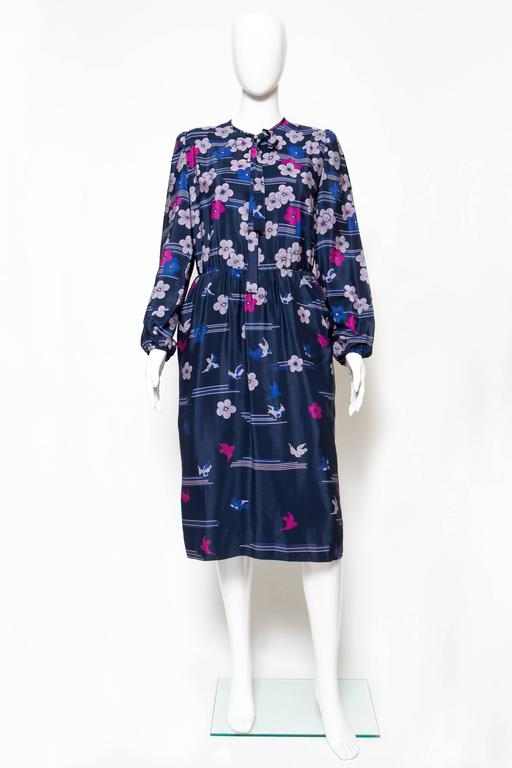 1970s Lanvin silk printed dress featuring a gorgeous placed flower print, long sleeves, a little pussy bow. In excellent vintage condition.  Made in France. Estimated size: 36fr/ US4/ UK8 We guarantee you will receive this gorgeous  iconic as