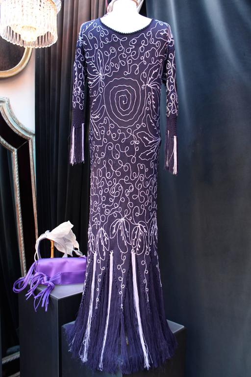 JOHN GALLIANO (Made in Italy) Long knitting dress composed of purple and parma cotton mesh figuring swirls and finishing with fringes of cotton mesh. 