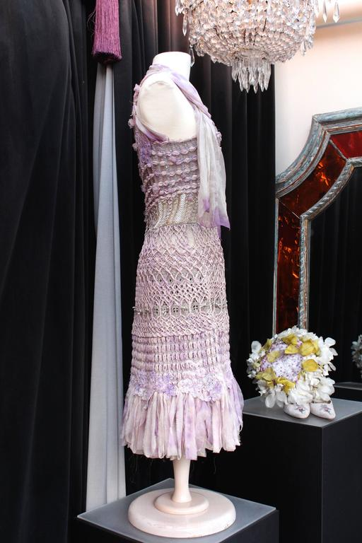 CHRISTIAN LACROIX (Haute Couture) Dress composed of knitting crochet of several fabric in parma tie and dye shades interlaced with silk muslin and lame threads and adorned with multiple small silver metal bows and white Swarovki crystals displayed