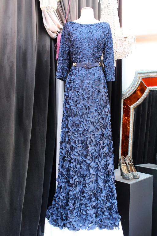 HELENE GAINVILLE PARIS Long evening gown composed of dark blue silk petals displayed in gradient sizes, all embroidered by hand on a blue tulle. Each petals is centered by a small blue beads.