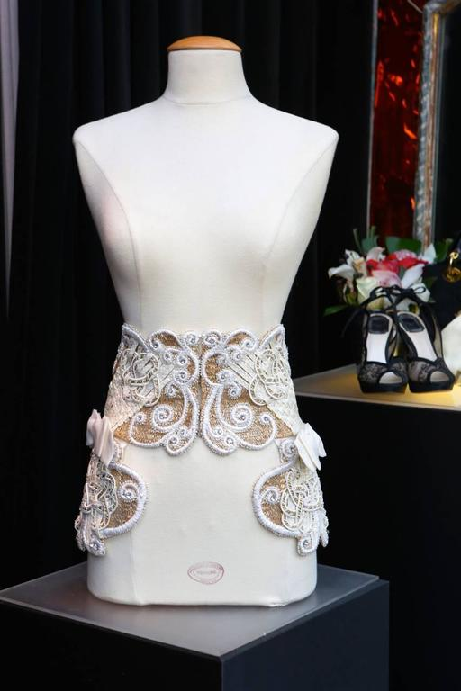 CHRISTIAN DIOR BOUTIQUE Magnificient ornemental belt/waistband consisting of white acrylic threads braided, multiple lame tubular beads, white crystals, and white and gold tone passementerie paved with thin faux pearls in an arabesque pattern.