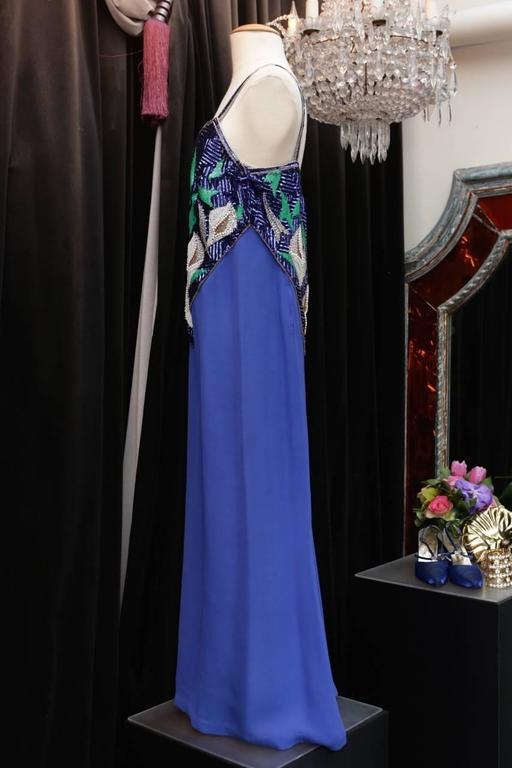 PIERRE BALMAIN PARIS Evening dress in electric blue viscose with thin straps whose bustier is entirely embroidered with faux pearls, green and electric blue sequins, and tubular copper color beads in a vegetal motif.   Zip on the right side.   Lined