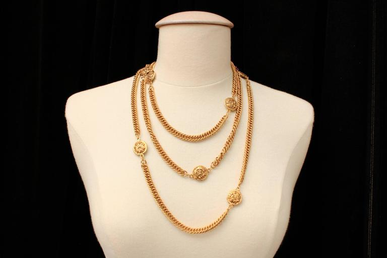 Women's Early 1990s Chanel Gilt Long Necklace with Medallions For Sale