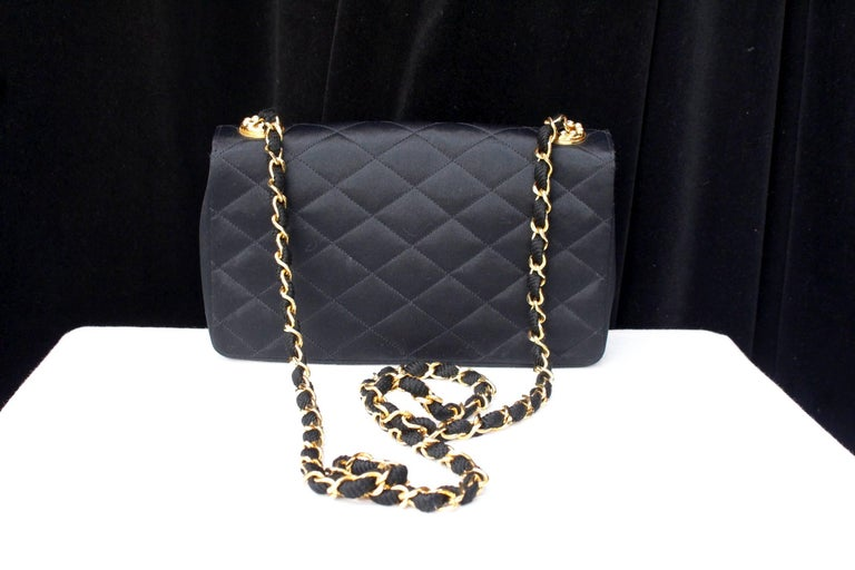 Black Chanel black satin clutch with golden hardware For Sale
