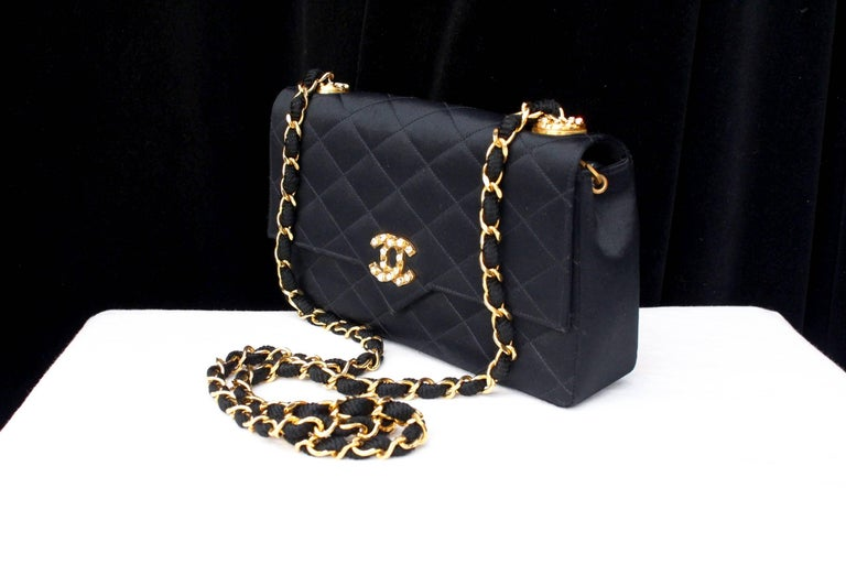 Women's Chanel black satin clutch with golden hardware For Sale