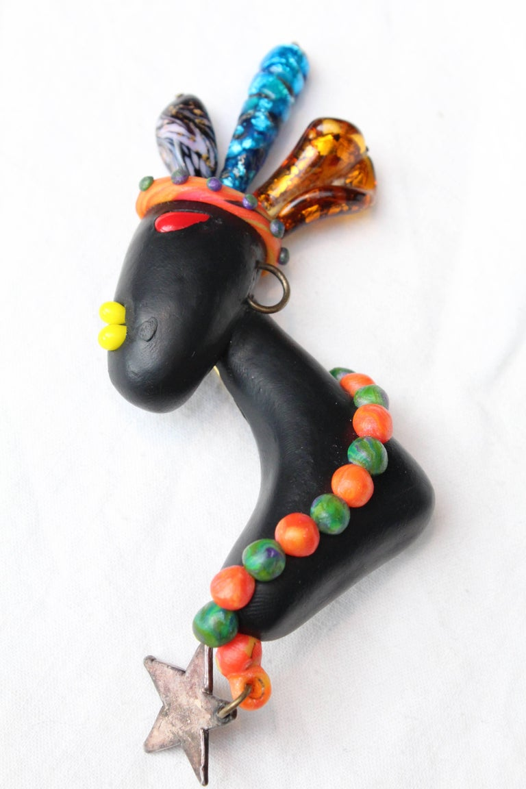 1990s Chanel rare brooch representing a young African woman 4