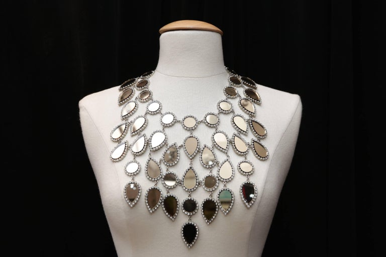 NINA RICCI HAUTE COUTURE  (Attributed to) Gorgeous breastplate necklace composed of silver plated  teardrop motifs and circles embedded with mirrors circled with Swarovski crystals. Hook and eye clasp with a small chain.  Unsigned.  Circa