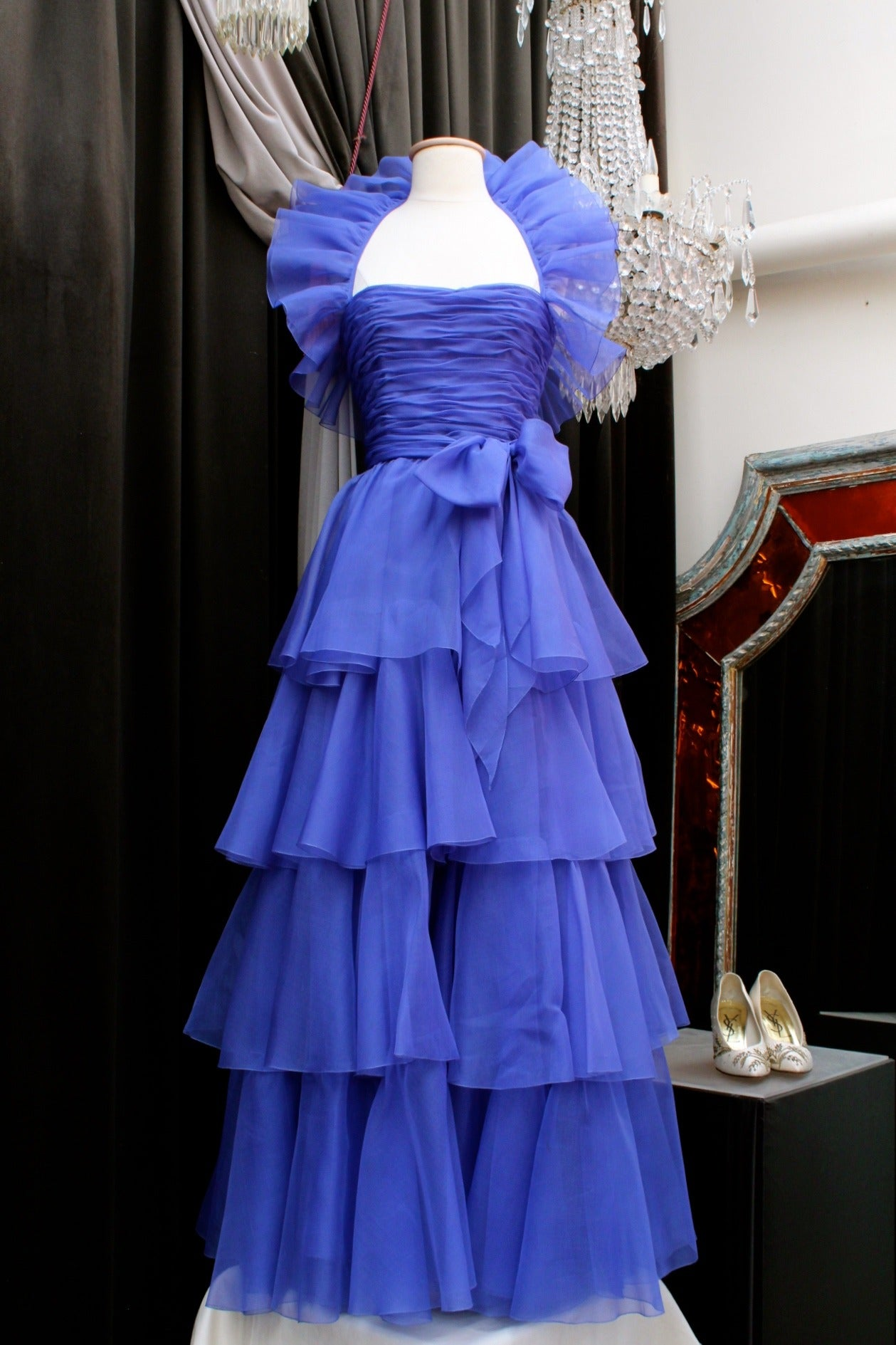 Beautiful Haute Couture evening gown by Jean-Louis Scherrer from the 1980s, composed of a blue silk organza draped corsage adorned with flounces running around the neck, and with a long skirt of organza large flounces.  There is also a waistband of