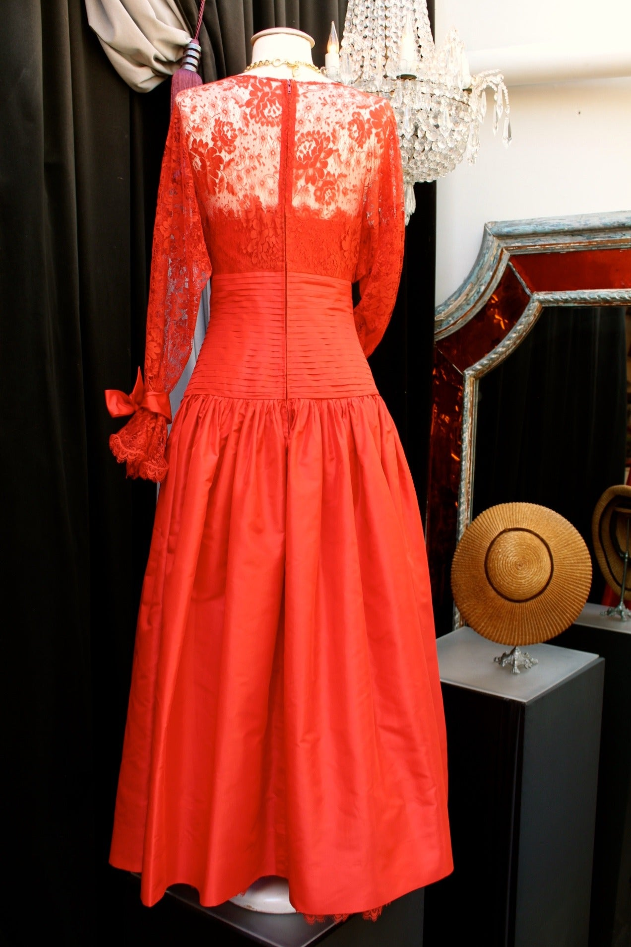 NINA RICCI HAUTE BOUTIQUE (Made in France) Red Taffeta and Lace Evening Dress consisting of a long crinoline skirt with a waistband made of pleated bands of traffetas and lace sleeves tight at the wrists by red taffeta ribbons . Closed in the back