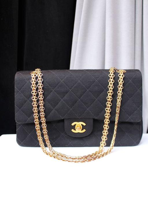 987e60b9cdc6 CHANEL Vintage timeless shoulder bag made with black quilted jersey and a  beautiful gilt metal chain