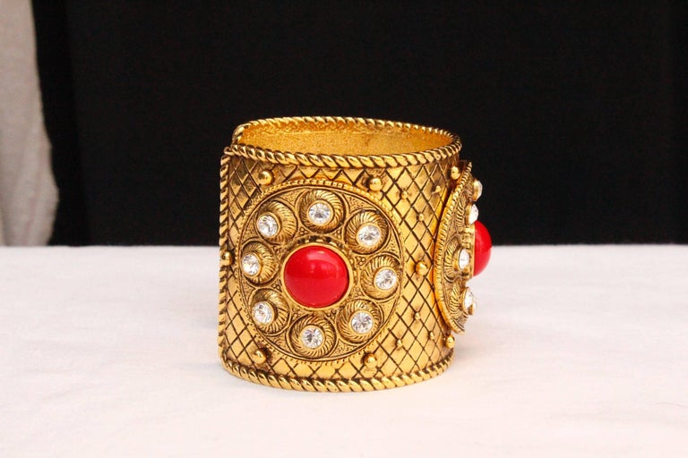 Women's 1990s Christian Dior gilded metal cuff with rhinestones and red cabochons For Sale