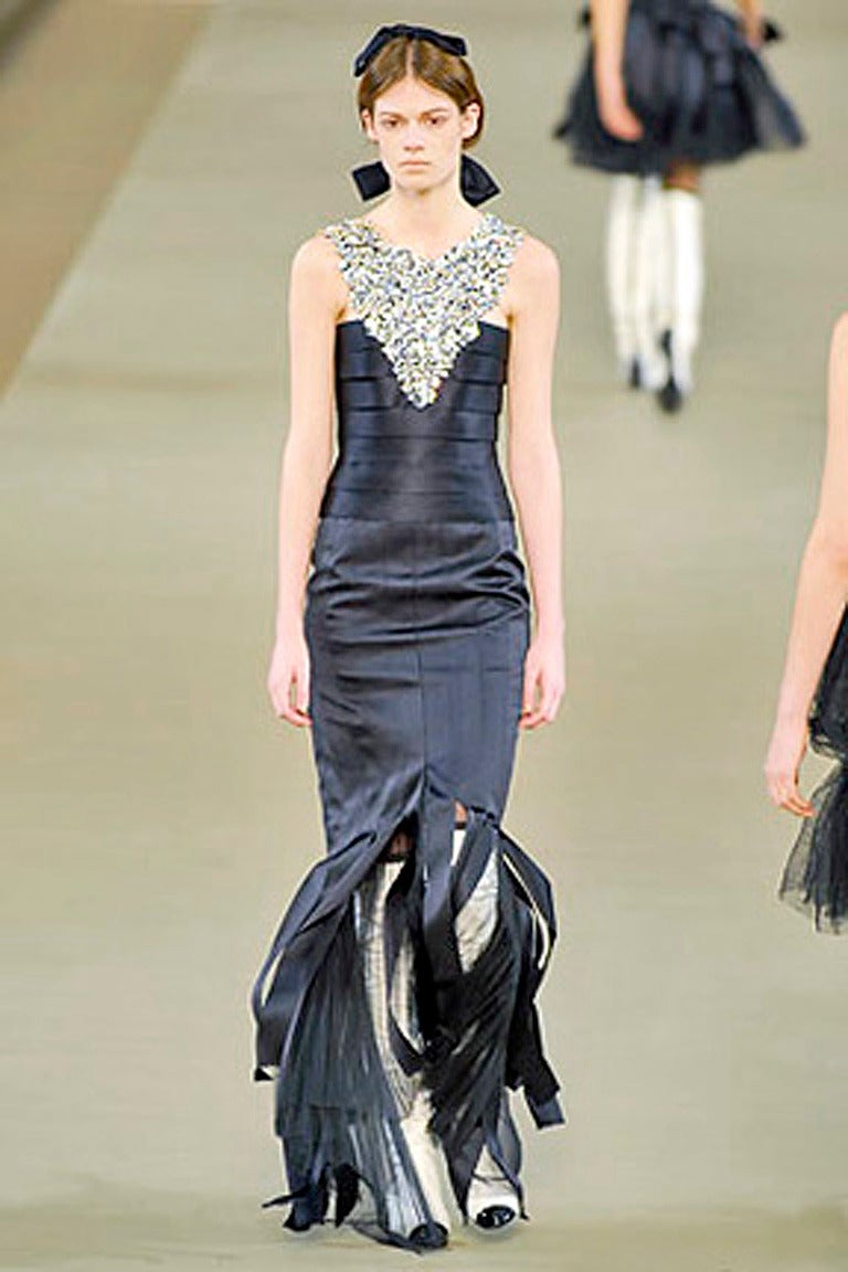 Rare Chanel black silk gown from Fall 2006 as seen on the runway. Gown fashioned of black silk/satin with attached large inverted