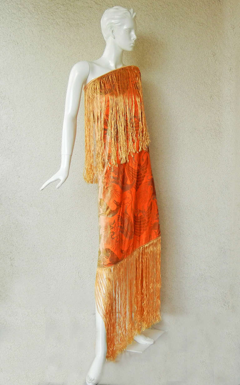 A rare stunning rich apricot panne velvet Gallenga fringed shawl circa 1920's.   The textile art of Maria Monaci Gallenga is often compared to that of Mariano Fortuny because they both produced hand-stenciled designs that drew inspiration from the
