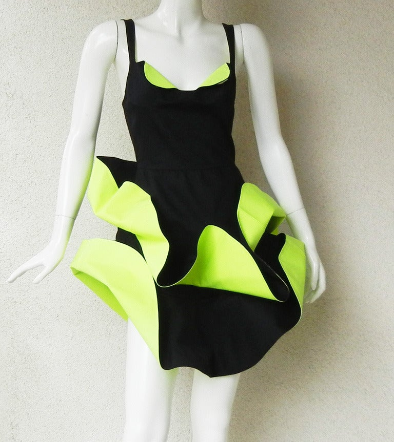 Rare circa 1989-90 Thierry Mugler petal dress. During this period the designer created a few different versions of this style of which this is one.  Fashioned of heavy black cotton with lime green inserts. Boasts fitted corset bodice and adjustable