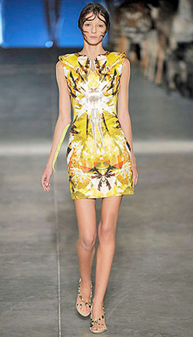 Alexander Mcqueen's Spring 2009 collection showcases the romantic, ethereal and purist side of the designer in his effort to send his message regarding the evolution of the world in the 21st century. This collection is considered to be one of his