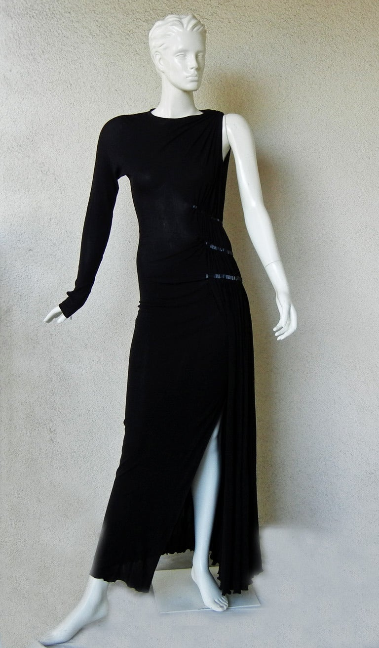 Stunning Gaultier one shoulder evening dress that is designed with just the right balance of edgy and classi, sexy and reserved and simple and sophisticed.  Perfectly constructed and designed for immediate visual fashion impact.  Side detail of