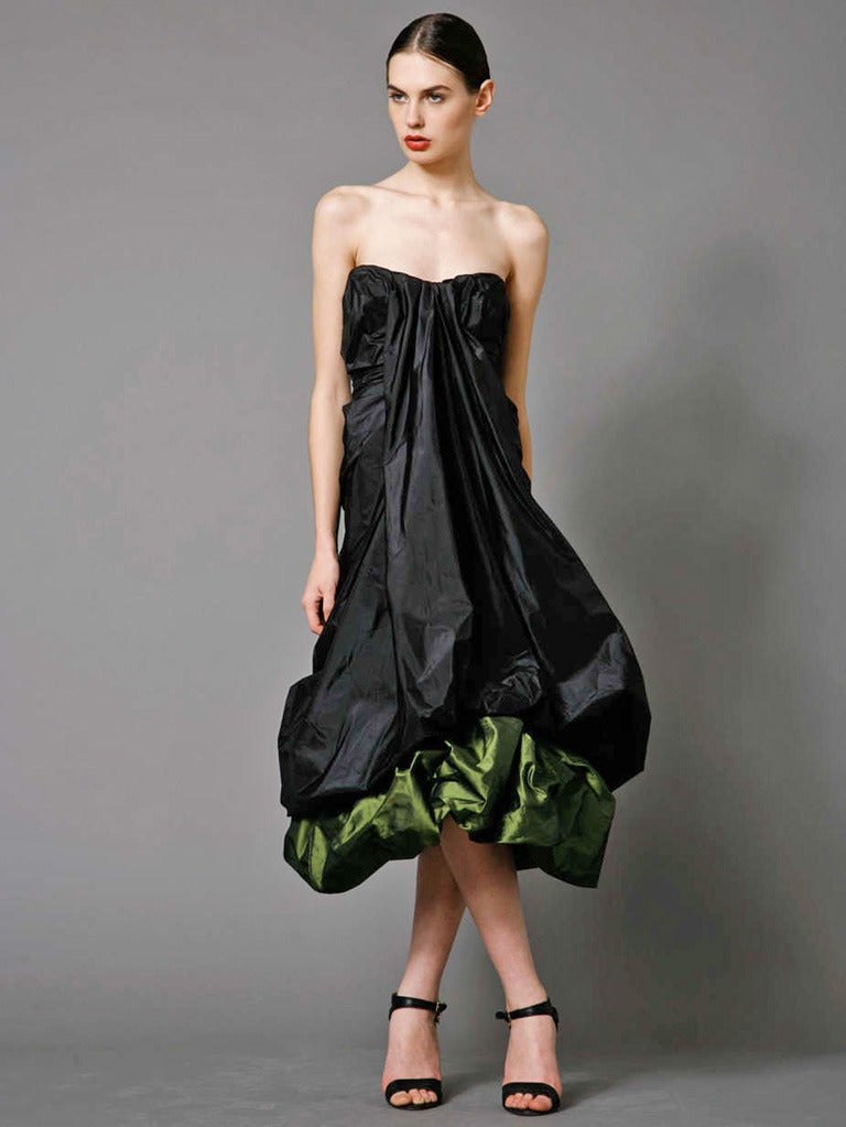 Alexander McQueen strapless two-tone black and petrol green tissue taffeta evening dress. Bustier with draped center detail and ruching all throughout. Balloon hem with contrasting layer underneath. Hidden corset top with slight boning and internal