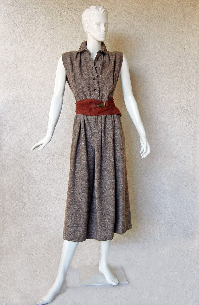 Circa 1940's Claire McCardell monastic style dress.    This was the first successful silhouette designed by McCardell and is now rare and hard to find.    Dress is a waistless, dartless, and tent style bias cut garment.  Very functional and can be
