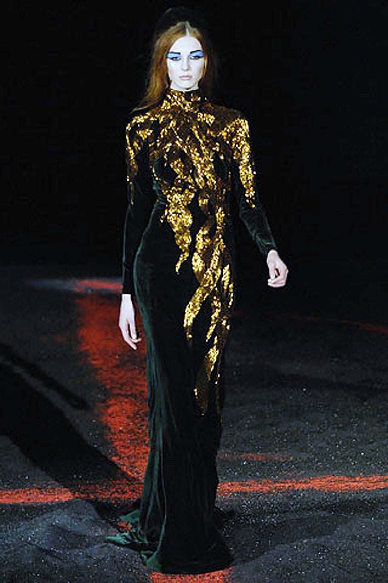 Alexander McQueen's notable flame gown in rich green silk velvet. Features outstanding antique gold bugle beaded flame motif. A strong fashion statement of high drama and bold impact.