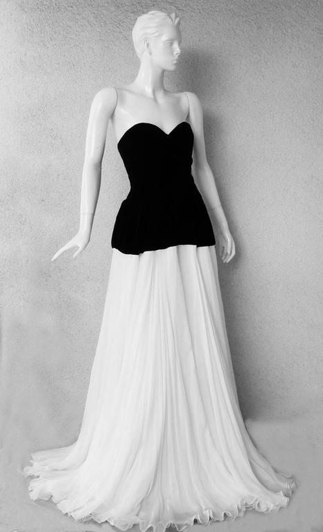 Alexander McQueen 2009 romantic fantasy holiday gown.    Strapless bodice fashioned of rich black velvet with panniers at each hip extending into full voluminous layers of white silk chiffon.  Stunning style that will always remain a classic.  A
