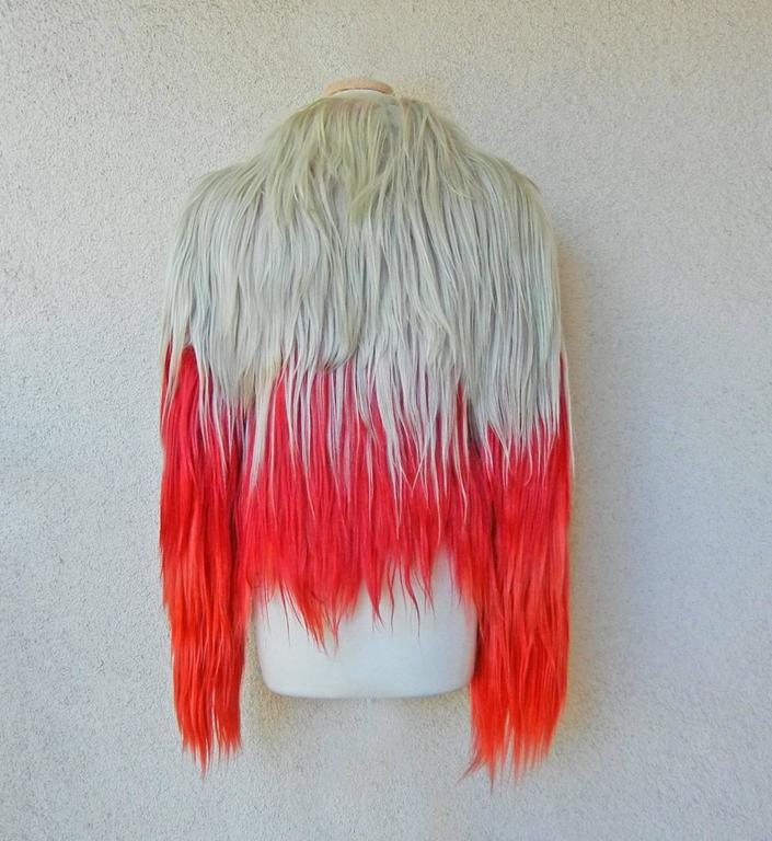 Hi style fur jacket by Tom Ford. Sold at Bergdorf Goodman and featured on cover of their catalogue and other ad campaigns.  Offered brand new with tags.  Jacket fashioned of genuine goat fur in an ombre pattern of platinum, red and orange shades.