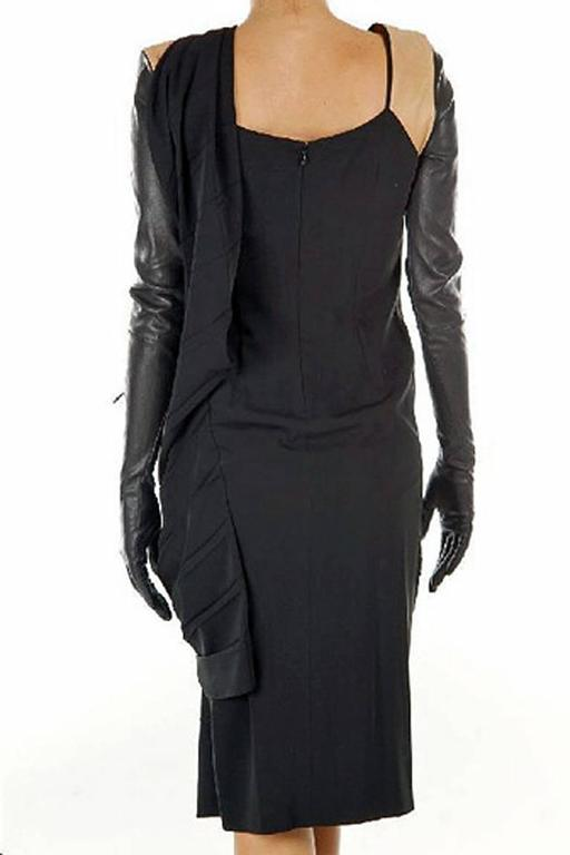 Martin Margiela dress fashioned of black silk crepe with soft lambskin saddle color leather at shoulders with attached black leather zipper long gloves. Asymmetricallyl draped and pleated around torso. Dress can be worn in 2 ways (see photos).