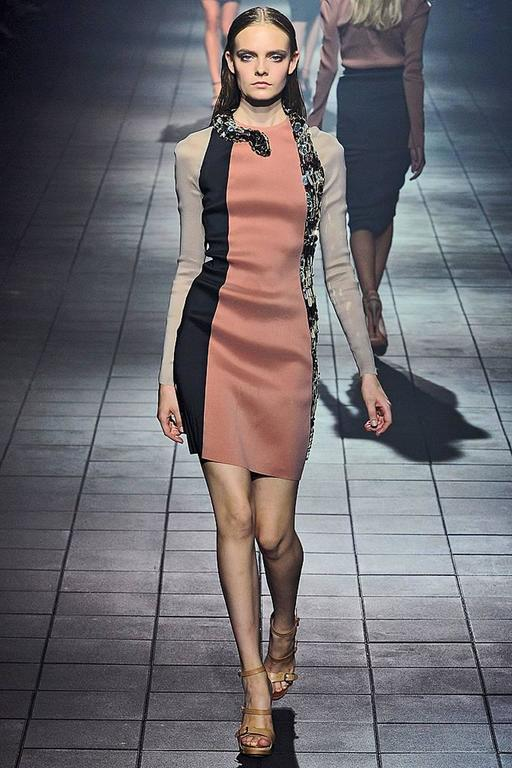 Lanvin 2012 mirrored serpent dress as seen on the runway and also worn by Jennifer Lopez.  Body hugging style fashioned of wool, silk and poly stretch in colorblock shades of black, camel and beige.   Fabulous handsewn mirrored oblong hexagons with