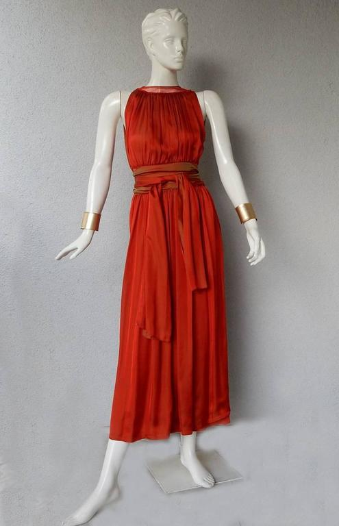 Jean Paul Gaultier diaphanous silk maxi  dress.  Fashioned of rich iridescent cayenne silk with pleated bodice, sheer net waist, flounce hem and button closures at shoulder and side.  Also included separate half underskirt.  Long double wrap obi tie