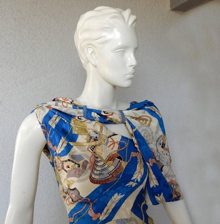 Late 1990's - 2000 Christian Dior by John Galliano asymmetric bias cut silk maxi dress.   Fashioned in rich blue, gold and creme in a scarf print pattern.  Asymmetric neckline constructed of silk with narrow strip of denim fabric with loops