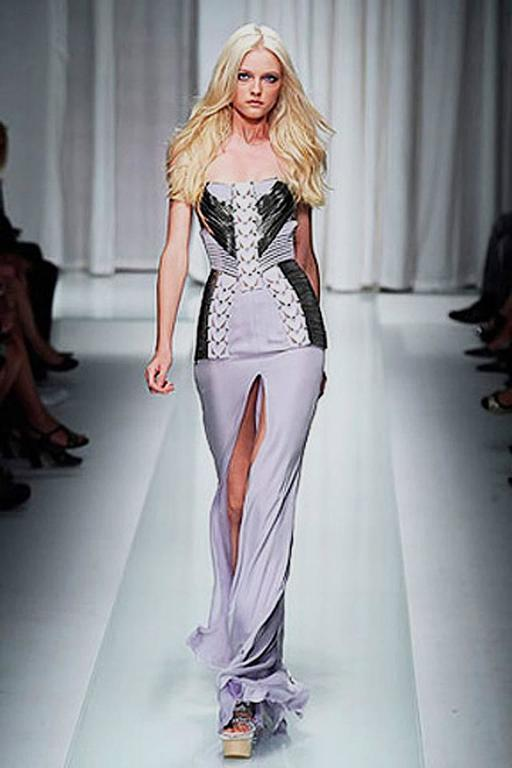Versace strapless lavish lavender gown fashioned of 4-ply silk, softest lambskin leather and trimmed in silver metal. Corset interior. From the Versace Spring runway 2010 collection. Rare and hard-to-find.   See Donatella wearing the dress in photo.