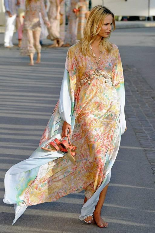 This Chanel caftan opens the 2011 Resort show with the backdrop flavor of the French Riviera.  Lightweight caftan fashioned of a silk and cotton blend in soft pastel color print with tie belt cinched at waist.  Ideal to wear paired with pants,