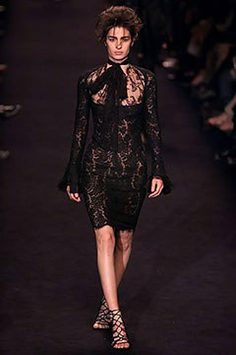 Tom Ford's F/W 2002 collection for Yves Saint Laurent  was deliciously sexy, erotic and just a bit wicked.    Just gazing at the runway creations one couldn't help but want to wear, or collect, these provocative pieces!  This black chantilly lace