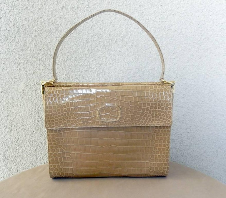 Beautiful and rare Roger Vivier taupe crocodile handbag from S/S 2011 Couture Collection specially ordered and very very limited in production.    A highly coveted bag from the Vivier Couture Collection.    Constructed in smooth rich lustrous