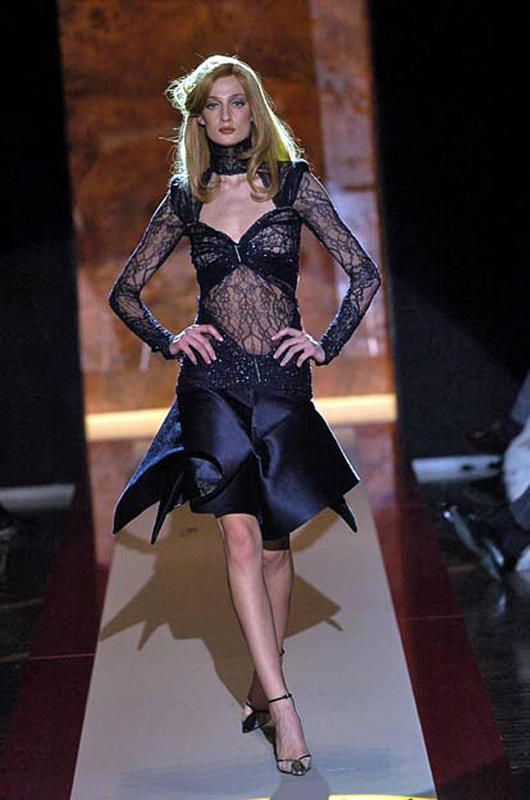 Gianfranco Ferre's highly architectural avant garde creation, designed with an art deco influence, is truly unique and imaginative in an amazing innovative and structurally breathtaking design  Garment consists of 2 pieces; a lace bodice with hints