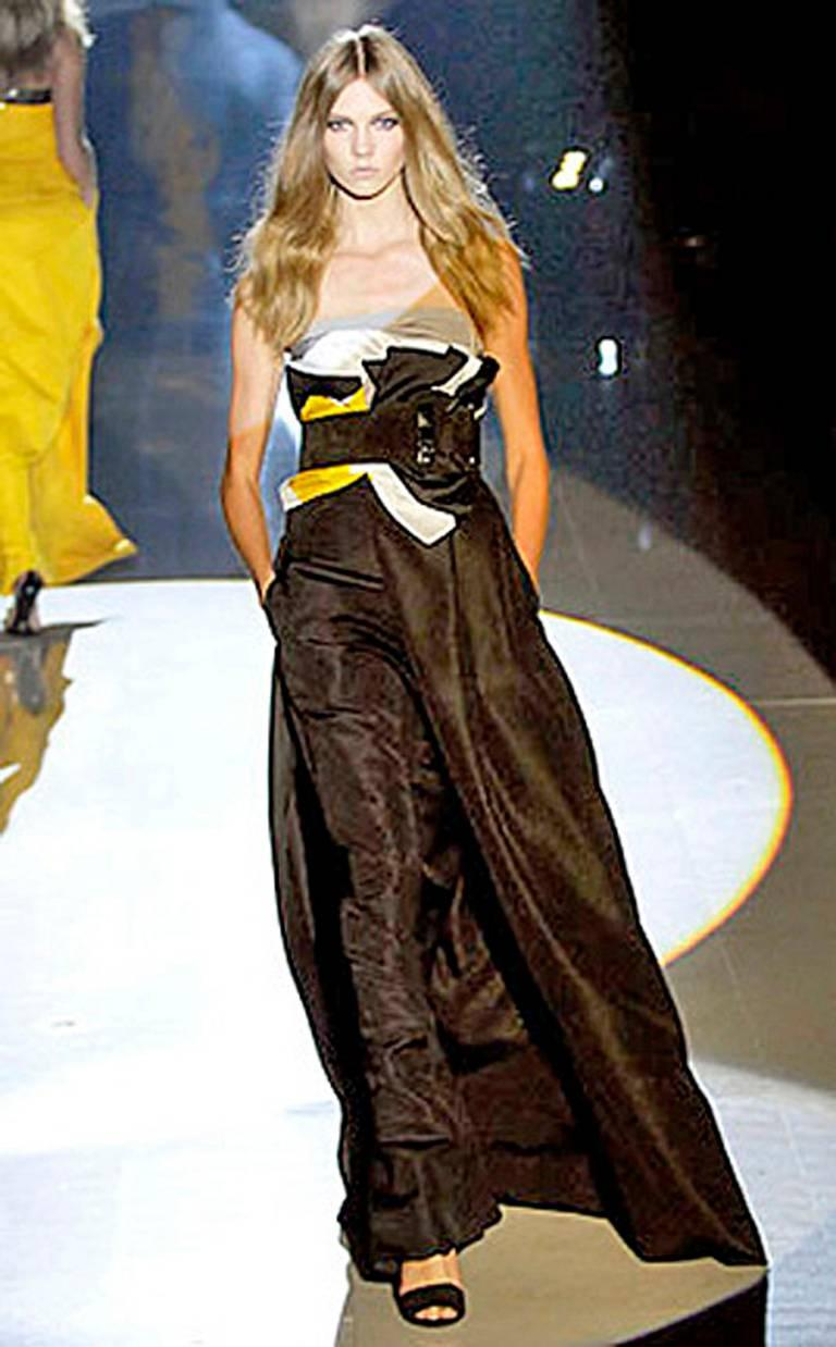 Fabulous, imaginative, and over-the-top Gucci gown from the 2008 runway collection. This collection boasts dramatic dresses and gowns accompanied with oversize horsebit belts, a Gucci style signature.  A hard-to-find piece.  Featured in Vogue