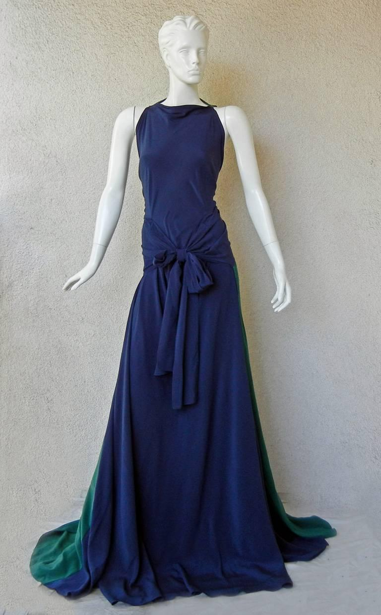 Vionnet navy and emerald green silk crepe de chine gown with crisscross back and tie waist. Bias cut with a flowing drape to the body.  Stunning colorblock pattern showcases a very visual and dramatic back and train.   Concealed button fastening at