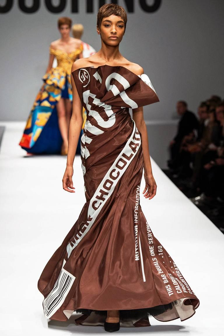 """By Jeremy Scott for Moschino. Re the Fall 2014 show, according to fashion reviewer, Tim Blanks, """"Scott's embrace of consumer culture in the name of Moschino was bright, brash, and ingenious.""""  Strapless ruched and twisted fabric into a mermaid"""