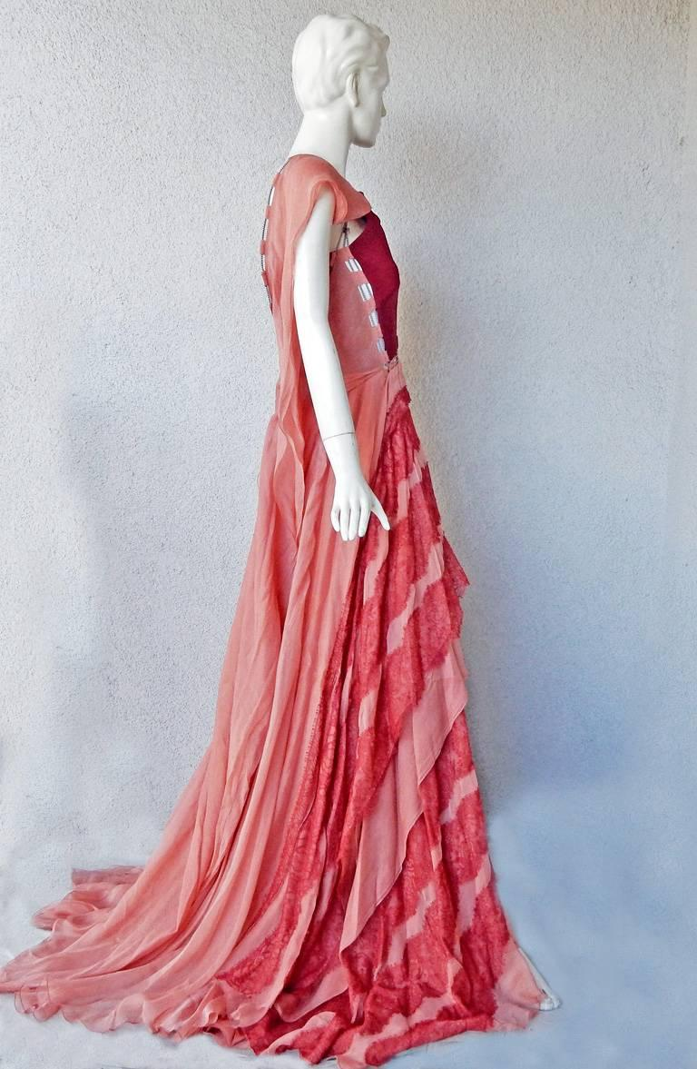 A stunning poetic billowing silk gown by Antonio Berardi.   A different color way of the gown was shown at the finale of the 2017 collection.   Halter style sleeveless gown with fitted bodice of silk crepe combined with billowing two-tone layers of