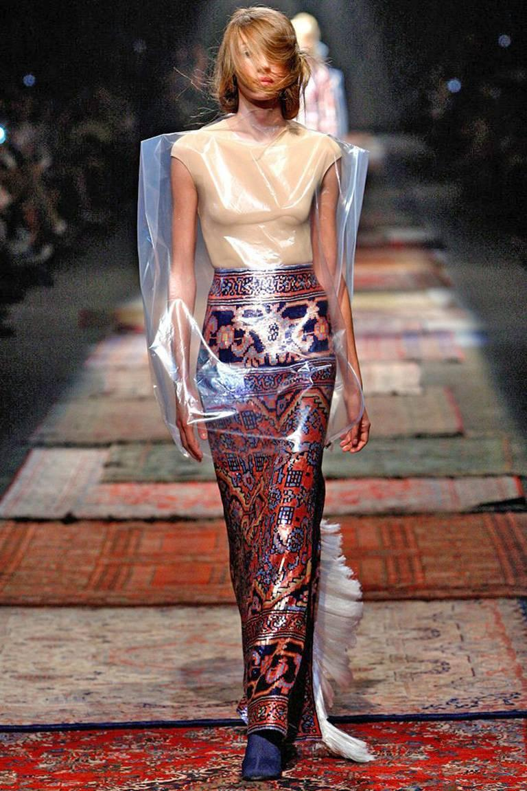 """Spring 2012 Maison Martin Margiela's collection of exquisite evening wear inspired by Asian theme tapestry. One could picture this """"wearable art"""" sequined number out at a fashion party or special event.  Long evening skirt fashioned in multi color"""