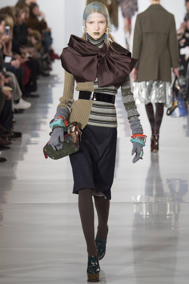 Stunning Masion Margiela mixed media asymmetric sweater adorned with large bow at shoulder.  As seen on the runway (see photo).  One of the best Margiela sweaters designed by John Galliano.   Fashioned of a soft wool, poly, viscose, and acrylic with