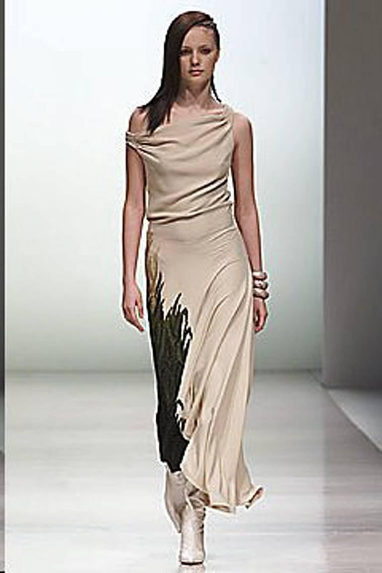 F/W 2001 by Stella McCartney for Chloe.   Bias cut  dress features a side asymmetric panel.   A draped cowl neckline with smocked shoulder straps fashioned in dune tan 4 ply silk crepe.  Unique sea-grass hand embroidery growing on the side adds a