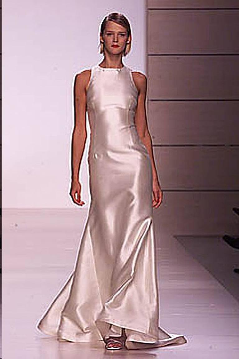 Valentino high fashion stunner from one of the designer's most exciting and sold out collections of 2001. Sleeveless racer back gown fashioned of off white shantung silk. Criss-cross double strap back adorned with clear Swarovski crystal adjustable