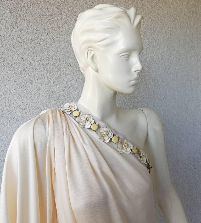 Lanvin eggshell white silk evening dress.  Bias cut one shoulder drape asymmetrical style with enamel floral clusters at neckline.  The enamel flowers are designed with a distressed vintage look. (see photo) Gown is fully lined with;  concealed side