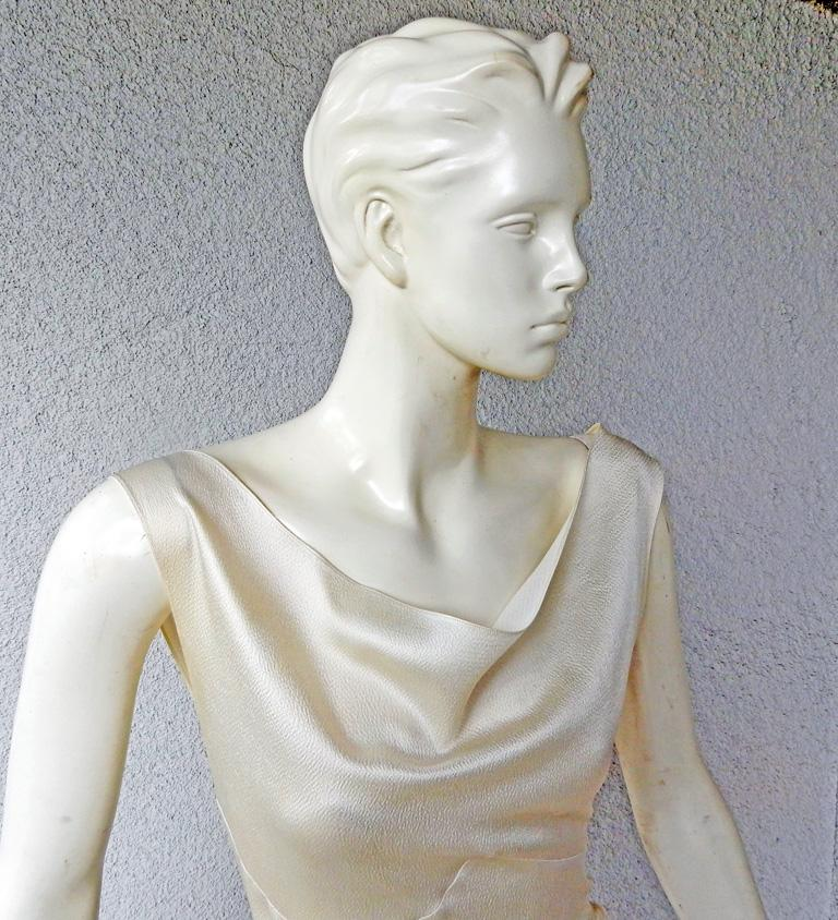 Circa 1990's John Galliano for House of Dior asymmetric bias cut gown.  Sleeveless cowl neckline with asymmetric treatment at hip.  Fashioned of off white weighty hammered silk. Zipper closure; lined.   Measurements:  bust: to 33