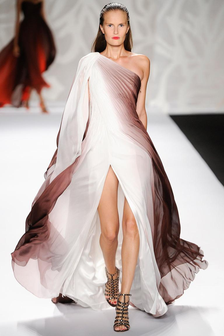 Lovely ethereal runway evening gown by Monique LHuillier.  Fashioned in earthtone shades of ombre silk chiffon.  Stunning one shoulder grecian gown with fitted ruched bodice extending into voluminous flowing skirt.  Fully lined. Side zipper closure.
