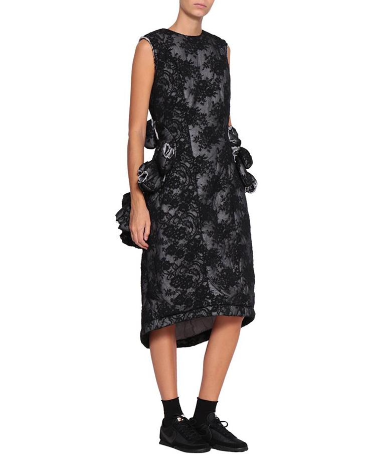 Comme des Garcons black padded floral lace dress adorned with raw edges.  Zip closure at back. Composition: 65% cotton 35% nylon    From the collection of
